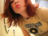 Check out this redhead teen cutie putting on makeup