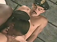 Busty black whore in the prison cell blows white dick