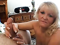Fat mature woman with huge breasts gives her lover an amazing blowjob