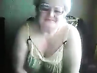 Fat and nasty granny on webcam flashes and masturbates