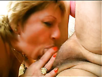Two lewd milfs suck a cock and get fucked hard in FFM scene