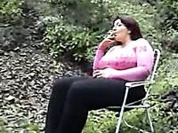Busty brunette mature woman showing her boobies outdoors