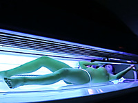 Perfect busty brunette babe in the solarium naked on hidden camera
