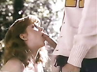 Stunning redhead college girl gives great blowjob to a horny guy
