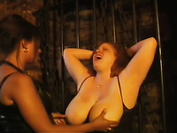 Hot BDSM scene with a tubby woman getting her boobs whipped