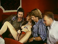 Salacious retro milf enjoys ardent gangbang sex indoors
