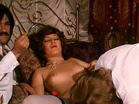 Slutty queen in bed with a couple of her secret lovers