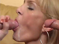Mature blonde babe takes two large cocks in her mouth