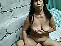 Freaky old Asian cougar flashes her saggy titties and pussy