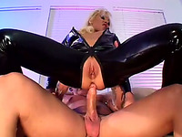 Lewd blonde milf in latex overall gets double penetrated