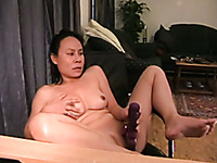Solo masturbation video of hot milf reaming her pussy with dildo