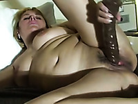 Amateur chubby white woman reaming her twat with large dildo