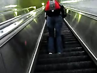 This sexy chick gets on an escalator and has no idea I am spying on her