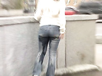 Just an amateur brunette chick in jeans peeing in her pants in public