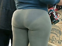 Candid juicy booty in tight pants filmed on the street