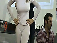 Hot and sexy brunette cover model in tight white outfit