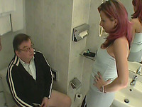Nerdy old dude gets his dick sucked by a redhead slut in a toilet