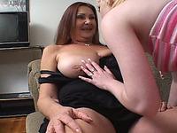 Mature redhead lesbian lets a blonde girl lick her big tits