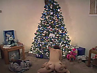 Juggy amateur slut rides a cock in front of a Christmas tree