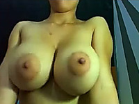 Unthinkably hot chick with huge tits masturbates for me on webcam