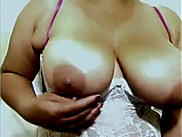 Latina milf demonstrates her big natural tits for the webcam