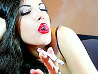 This naughty lascivious brunette girl smokes so seductively