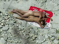 A horny young couple on the nude beach having sexy time
