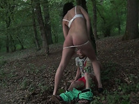 Sizzling brunette sucks and rides a hard cock in a forest