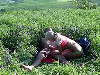 Blonde skank enjoys sucking and riding a cock in the field