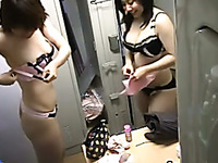 Two Asian amateur girls in the changing room caught on hidden cam