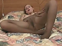 Concupiscent skank in sexy pantyhose loves touching herself on camera