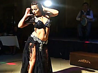 Mesmerizing belly dancing performance by a brunette hot milf