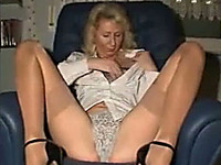 Mature amateur blonde fingers her pussy in homemade solo