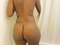 Lascivious ebony wife with big ass is getting naked on camera
