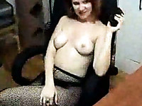 MILF redhead webcam whore in fishnet pantyhose shows me her juggs