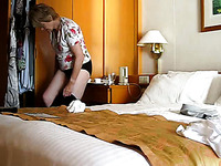 Mature blonde wifey changing clothes in the bedroom