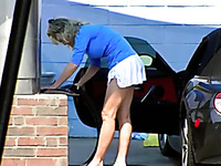 Blonde MILF in shorts skirt shows her ass at the carwash