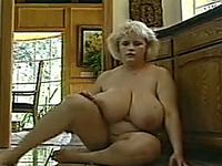 European bosomy BBW blonde milf playing with her big titties