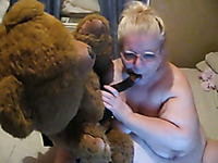 Fat blonde granny fucks a teddy-bear in webcam solo clip