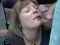 Mature co-worker pleases me with a blowjob in an office