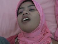 Cute Asian babe in hijab fucks in missionary style