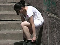 Amateur brunette Russian chick in white shorts pisses in public