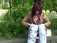 Redhead amateur skank pees in her pants on the sidewalk