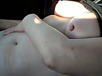 My chubby wife entertains herself by fingering her cunt in a car