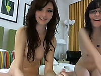 Two charming brunettes lick pussies during a webcam show