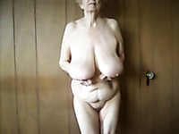 Lewd granny plays with her big saggy boobs in webcam solo vid