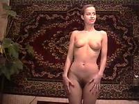 Perfect European girl shows off her marvelous body curves in the bedroom