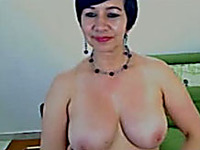 I am 50 year old woman with big tits who loves stripping for young men