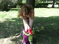 Sveta pees her pants while being bound to a tree in a park