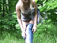 Olga pees her shorts in the street and goes to the park to change